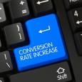 A Keyboard with Blue Button - Conversion Rate Increase. Conversion Rate Increase Concept: PC Keyboard with Conversion Rate Increase on Blue Enter Key Background, Selected Focus. 3D Illustration.